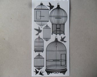 x 1 Board rub - ons representing cages and black birds
