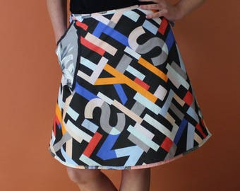 Wrap Skirt (one size fits most small - large) colorful lettering.
