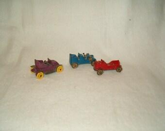 Three miniature cast iron Cars