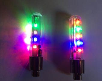Decorate your bike! Get a set of 2 or 4 motion activated LED lights for valve stem of bike/motorcycle. Light up your wheels! Be safe!