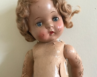 Adorable antique blonde composition baby doll