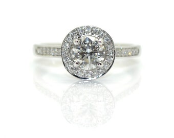 Circled in white gold ring and diamonds