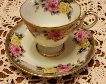 Bone china cup and saucer.  Occupied Japan. Floral design