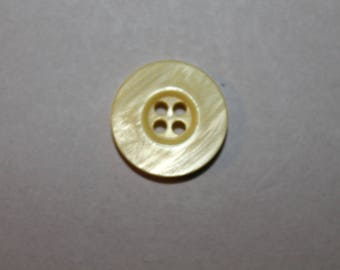 marbled yellow round button carved with four holes