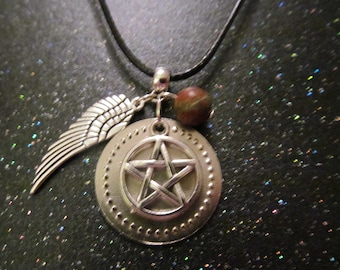 Pagan charm necklace on black cord. Pentagram, eagle wing and unakite stone bead cluster