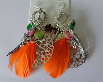 pair of earrings orange feather earrings