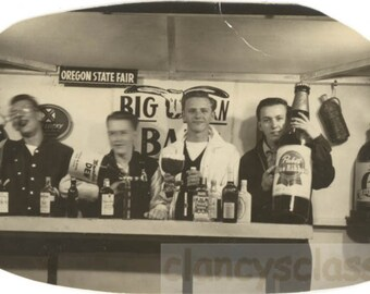 vintage photo 1957 Oregon State Fair Arcade YOung Men Drink Giant Beer