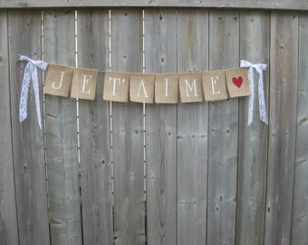JE T'AIME (French for I love you) burlap banner with a heart in the color of your choice.   Slim block caps