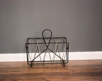 Black and gold magazine rack