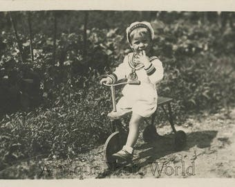 Cute boy in sailor suit on wooden tricycle bicycle antique photo