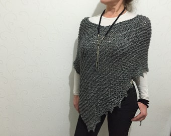 Womens poncho, black knitwear, wrap poncho, knit black and white poncho, poncho trends, casual knitwear, loose knitting, black white cover