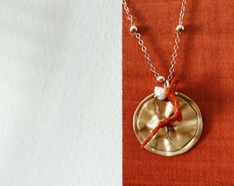 Necklace with chain with brass beads, coin pendant, corals and beads