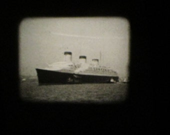 Vintage Castle Film - Pearl Harbor and The Burning of the S. S. Normandie   8 mm film on a metal reel