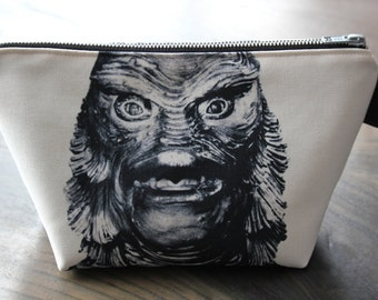 creature from the black lagoon - lined canvas zippered pouch - universal monsters