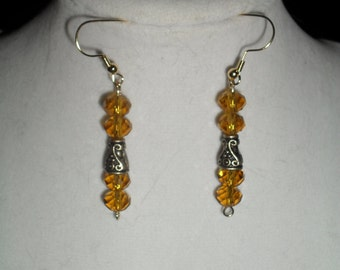 Amber-colored faceted glass bead earrings