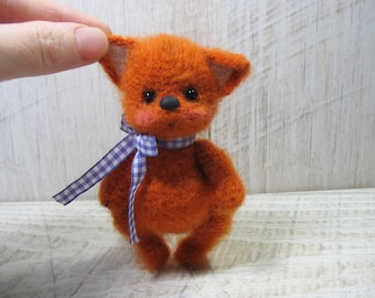 Miniature hand knitted Fox