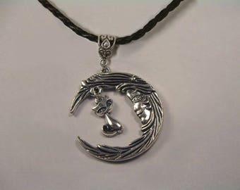 """Little rascal cat under plant Moon"" pendant"