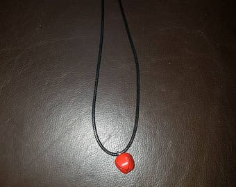 simple necklace with a red bell