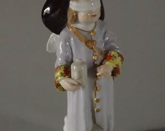 Rare Meissen Porcelain Blindfolded Angel Figurine