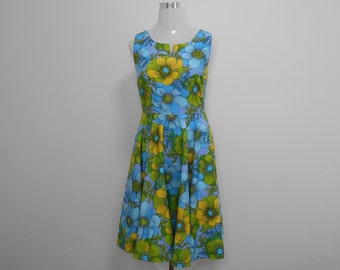 100% cotton poplin Sundress, circa 1960, sleeveless, fully lined. The skirt is a full circle with lining of hem reinforced to give fullest.