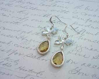 Silver orchid flower earrings with champagne glass drop