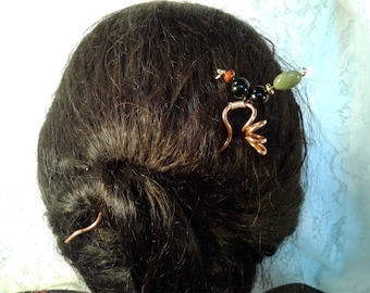 Copper hair stick with beads.