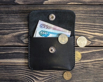 Small leather wallet for bills and coins. Black color.