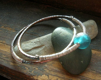 Copper Bangle Duo with Denim Blue Glass bead and sterling silver wire wrapping detail,small - average size