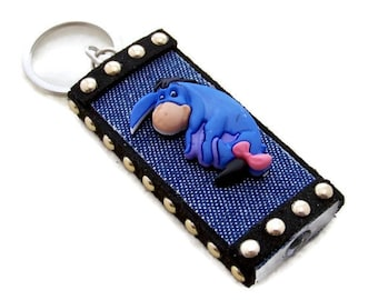 Eeyore Character mini flashlight key ring is blue denim with leather/gold studs; GREAT Gift Idea for Eeyore lovers.