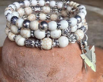 Handmade 3-wrap memory wire bracelet featuring white turquoise beads with tibetan silver beads, spacers, arrow and arrowhead charms