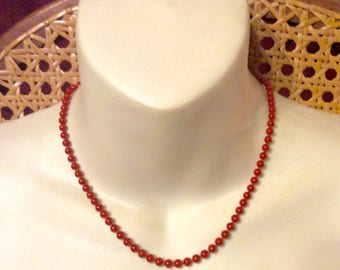 Designer signed KIM rust colored enamel on metal beads beaded necklace.
