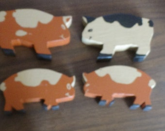 4 wooden Pigs.