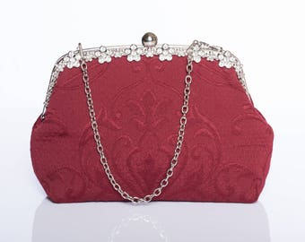 A Red rhinestone frame clutch