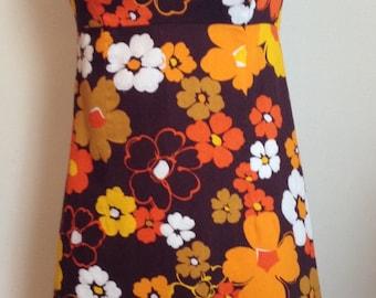 Vintage 1960s Hawaiian Sleeveless Empire Waist Shift Dress with Gold, Orange & White Floral Print