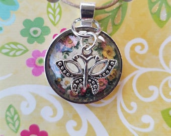Glass Floral Pendant with Butterfly Charm
