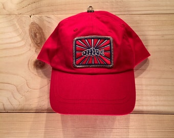 Red ToddlerHat with BadAxeDesign logo fly fishing artwork of Jonathan Marquardt