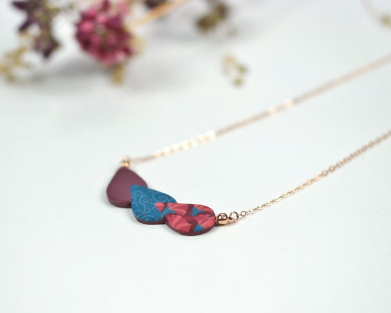 Rose gold filled necklace with burgundy and blue patterned leaves pendant