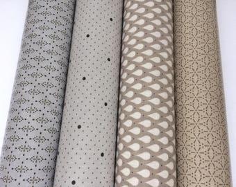 Assortiment de 4 coupons de toiles cirées tons crème, taupé et gris a motifs gouttes et pois - 50X46