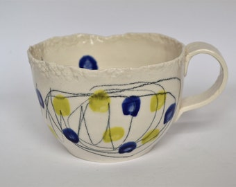 porcelain blue patterned coffee cup