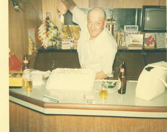 1960s Cutting The Cake in Style At the Bar Bartender 60s Vintage Photograph Color Photo