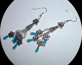 Tiny aqua crystal glass teardrops with silver flowers and cone.