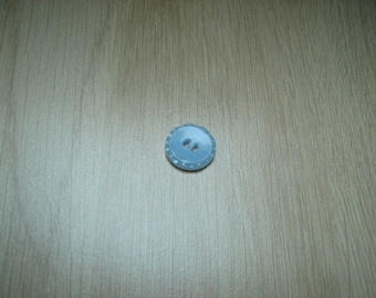 round blue buttons with design