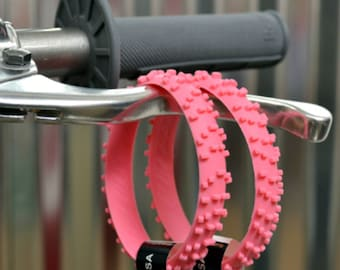 SET OF FIVE pink knobby dirt bike tire wrist band