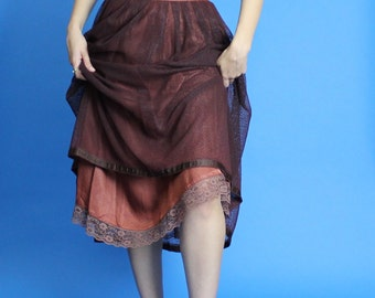 SALE. 1960s. dark brown a line. high waist skirt. with netted overlay. extra small