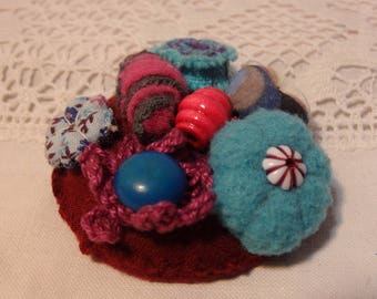 PIN or circular bar textile beads and turquoise and purple wool.
