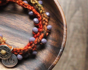 Crochet beaded wrapped bracelet with metal charm