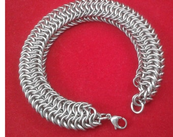Seriously chunky, snakey solid stainless steel chainmaille bracelet.  Gift boxed.