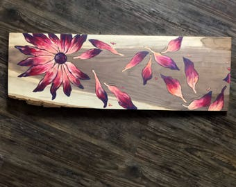 Bright and colorful flower with falling pedals painting on long wooden slab!