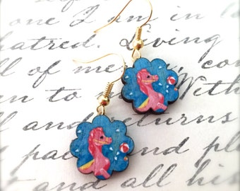 Little Pink Pony Wood Dangle Earrings. Wavy Flower Edging. Laser Cut Wood Earrings. Under 10. Lightweight. Cute. Gold. Whimsical. Horse