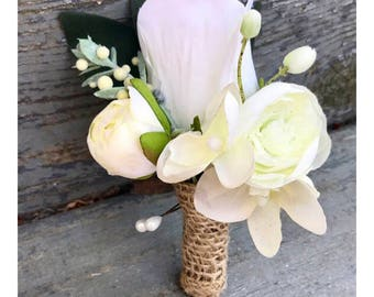 Rose and ranunculus boutonniere